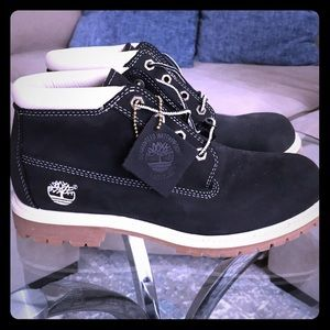 Never worn Black/White Timberland Ankle boots. 8.5